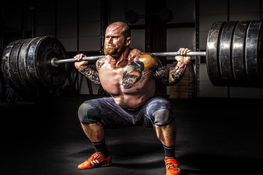 Man Power Lifter Squatting