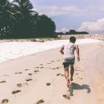 Man sprinting on beach - HIIT