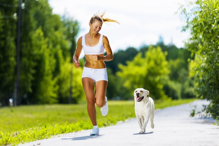 Woman running with her dog