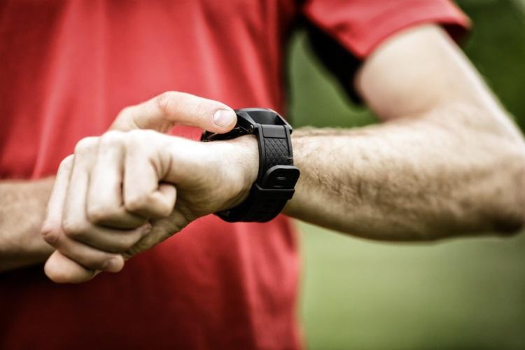 Runner Using Heart Rate Watch