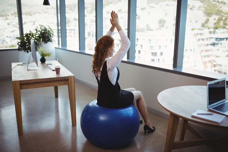 Sitting on an exercise ball at work