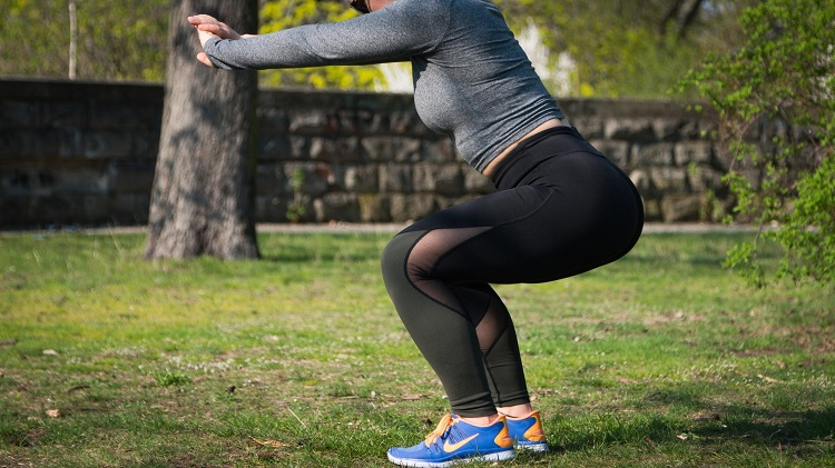 Woman working out in park at lunchtime